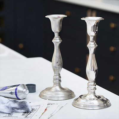 An image of two candlestick holder, one shiny after using Maas on it